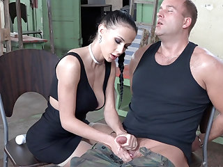 Sexy brunette impersonate with dick of military