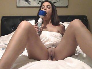 Good anticipating Jynx rubs their way pussy fro a vibrator while she moans