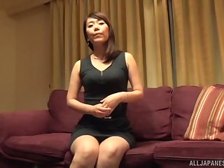 Busty mature Japanese takes off her skirt before a fuck and a creampie