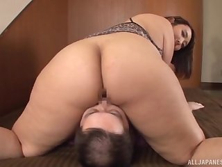 Chubby Japanese deals the cock like a pro