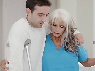 GILF physiotherapist Sally Dangelo gives a young man a bodily therapy