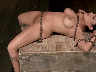 Busty chained slave gets whipped