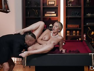 Sensual woman acts elegant on peak of a big fagged