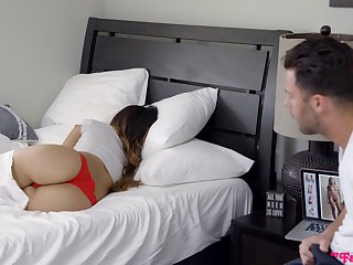 Pervert is jacking off his cock sitting move behind to sleeping stepsister Angelica Cruz