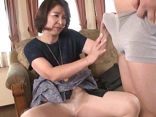 Mature Kitamura Toshiyo sucking a dick & receiving cum in mouth